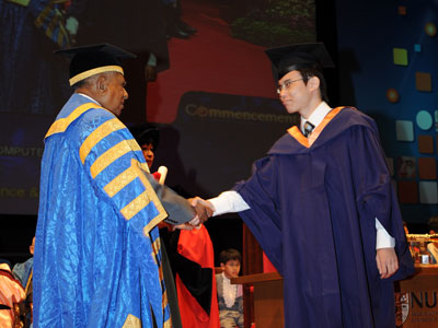 Receiving my degree scroll from President S. R. Nathan in a special ceremony for graduates with achievements