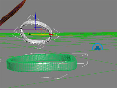 The state of the ring after bouncing off the ground. The blue icon represents the rigid body collection in 3dsmax.